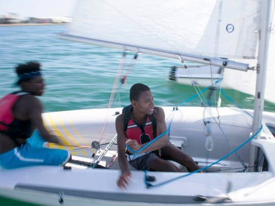 Jaden Walton, 12, right, and partner James Allen, 15, on the water during the Junior Sailing Program for Detroit youth at the Detroit Yacht Club on the Detroit River in Detroit on Tuesday, August 1, 2017.