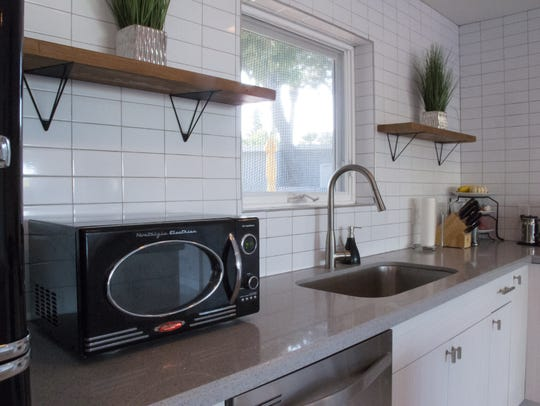 Although the kitchen has been completely updated, retro-style appliances honor the home's midcentury heritage.