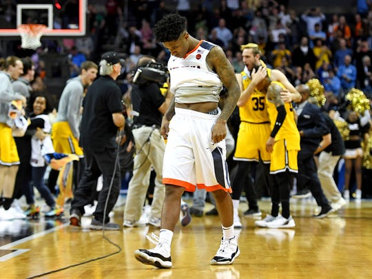 Virginia Cavaliers guard Nigel Johnson (23) reacts after loosing to the UMBC Retrievers in the first round of the 2018 NCAA Tournament at Spectrum.