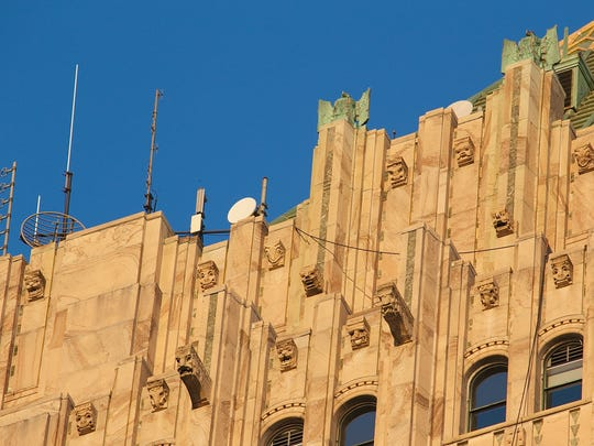 A small army of gargoyles guards the top floors of the Fisher Building.