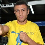 Vasyl Lomachenko poses during a recent media day. He will make his professional boxing debut on Saturday vs. Jose Luis Ramirez