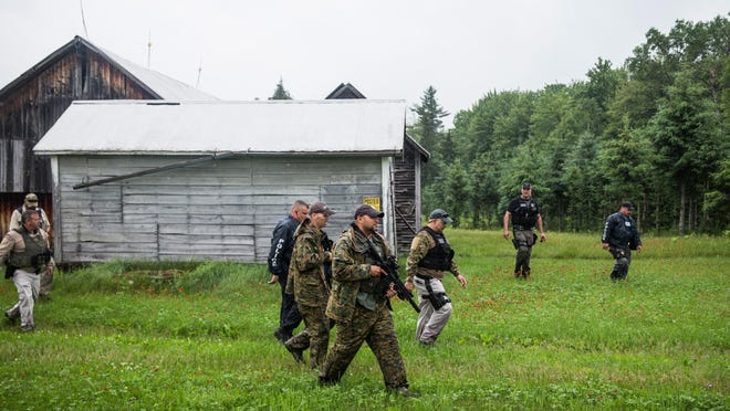 U.S. marshals and police officers search door-to-door in June for the two escaped convicts outside Dannemora. The two convicted killers, Richard Matt and David Sweat, were found; Matt was killed and Sweat is back in prison. But the manhunt was very costly in terms of overtime.