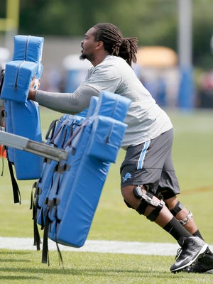 Injured Detroit Lions offensive lineman LaAdrian Waddle does some work against a blocking sled Aug. 7, 2015, in Allen Park.