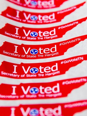 """New """"I Voted"""" stickers featuring the name of prominent Republican Secretary of State Tre Hargett are displayed on Friday, Oct. 10, 2014, in Nashville. The new stickers replace generic stickers handed out at polling places in past elections."""