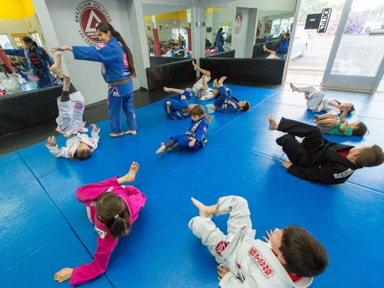 Angela Benitez, 38, leads a class of children at Gracie