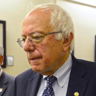 Bernie Sanders and Davenport Mayor Bill Gluba walk