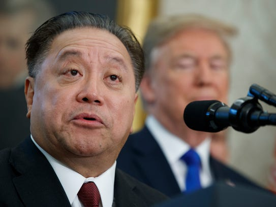 Broadcom CEO Hock Tan speaks as President Donald Trump