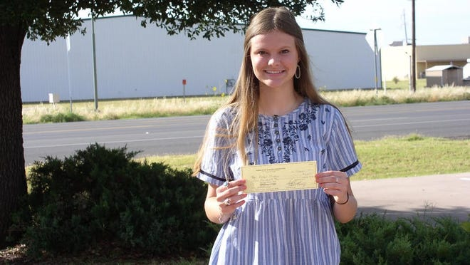 Rachel Niehues from Miles received her scholarship award from Runnels SWCD.