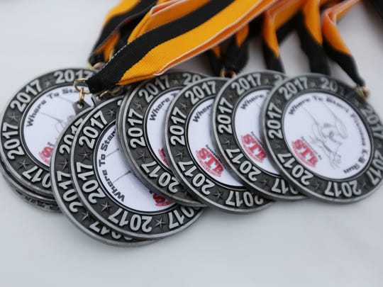 Awards for the annual K9 run on Saturday, April 1, 2017, in Stayton. The dog-friendly race supports the Stayton Police Department's K9 program. Courses (5K and 9K) included street and trail running.