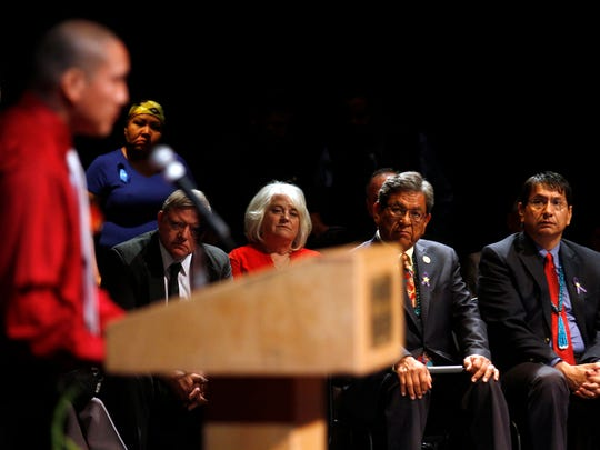 Ryan Begay, left, gives a eulogy for his sister Ashlynne Mike, as dignitaries, from left, Gary McDaniel, his wife, County Commissioner District 2 Margaret McDaniel, Navajo Nation President Russell Begaye and Navajo Nation Vice President Jonathan Nez listen, during the funeral service for Ashlynne Mike at the Farmington Civic Center on Friday, May 6, 2016, in Farmington, N.M. She was a budding musician and talented artist, a girl whose death at the hands of a man who authorities say lured her into his van spread grief far beyond her home on the Navajo Nation. More than 3,000 people turned out for her funeral.