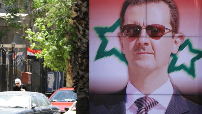 An election campaign poster in this most-miserable country's capital of Damascus bears a portrait of President Bashar al-Assad.