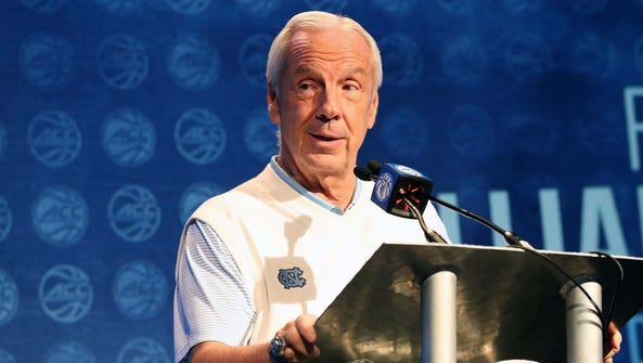 North Carolina coach Roy Williams answers questions