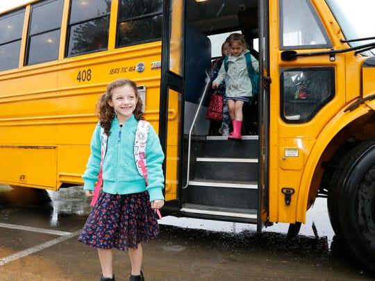 Glenwood Elementary School first-grader Olivia Tanton arrives to her first day of school Wednesday in Vestal.