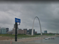 With the Gateway Arch just behind the welcome sign,
