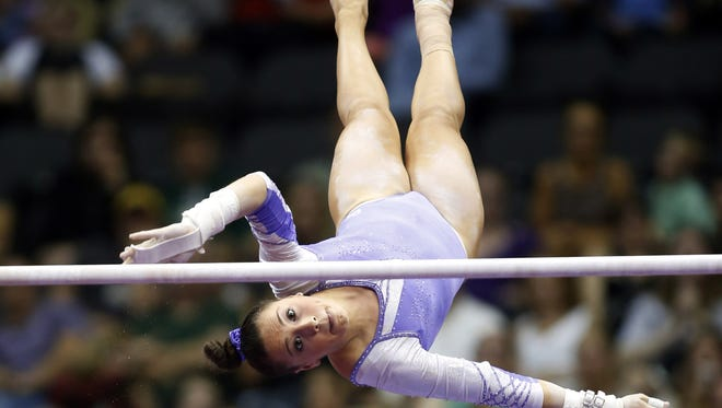 Amelia Hundley competes on the uneven bars at the 2014 P&G Championships at the CONSOL Energy Center. Mandatory Credit: Charles LeClaire-USA TODAY Sports