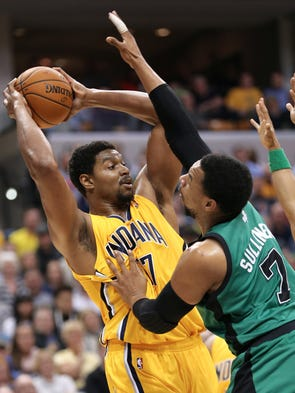 Pacers center Andrew Bynum is pressured by Boston forward Jared Sullinger in the first half of Tuesday's game at Bankers Life Fieldhouse on Tuesday, March 11, 2014. Bynum made his debut with the Indiana Pacers tonight against the Boston Celtics, playing in his first NBA game in nearly three months.