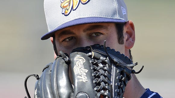 Biscuits pitcher Dylan Floro practices at Riverwalk Stadium on Monday, March 31, 2014.
