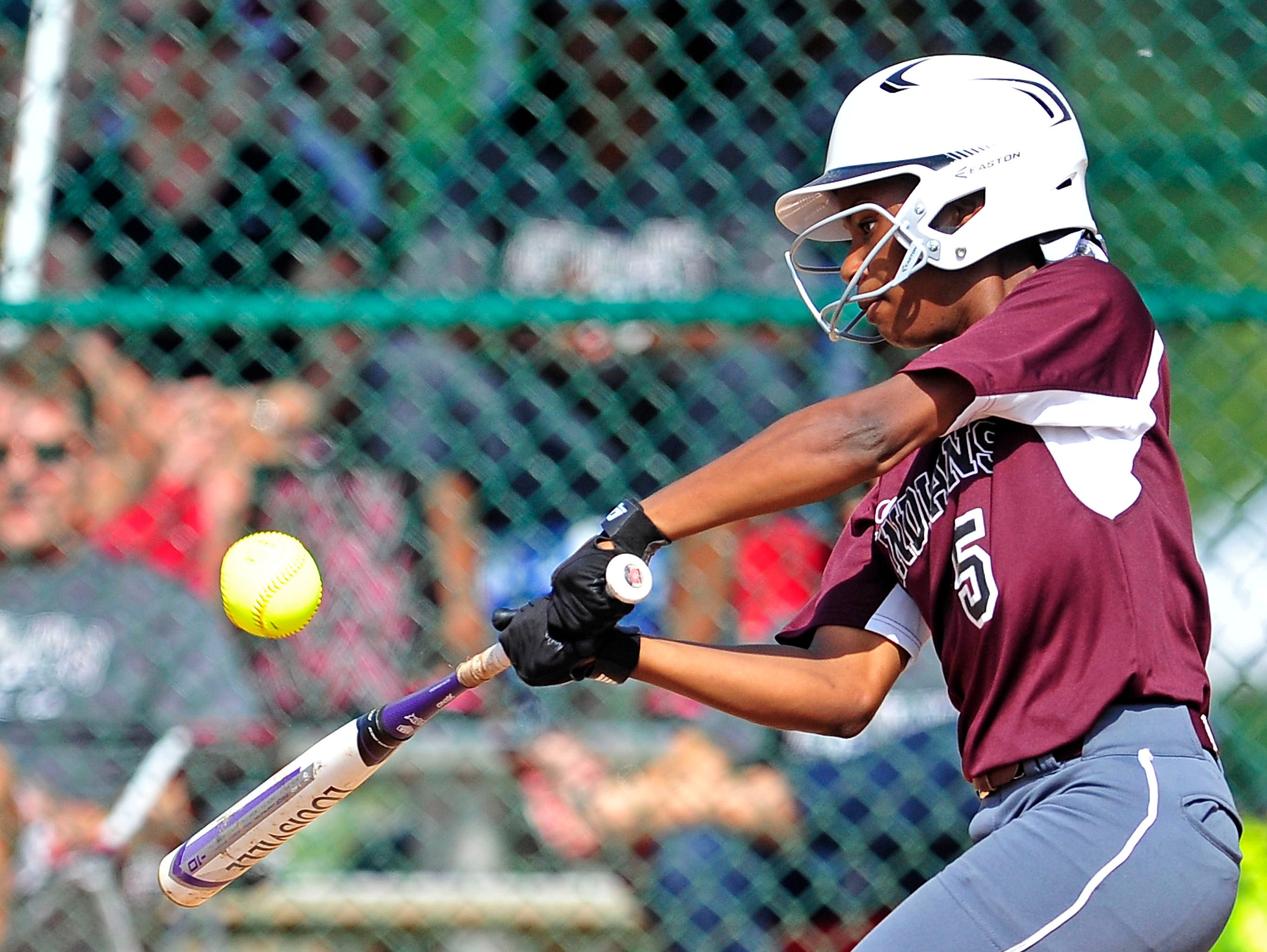 East Robertson's Dee Dee Dunn hits the ball against Marion County during Tuesday's Class A tourney game.