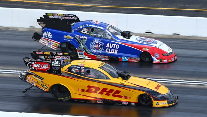 NHRA Funny Car drivers Del Worsham, near, and Robert Hight race side-by-side during the Route 66 NHRA Nationals.