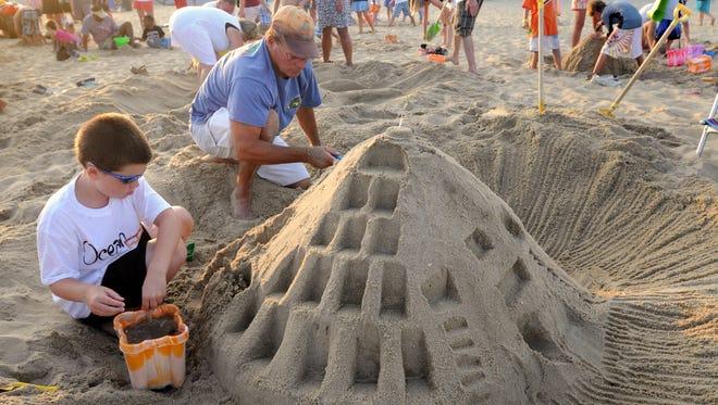 Tyler Eaken, left, and Terry Eaken of Tyrone, Pennsylvania, work on an elaborate sandcastle during a Family Beach Olympics event in Ocean City in 2009.