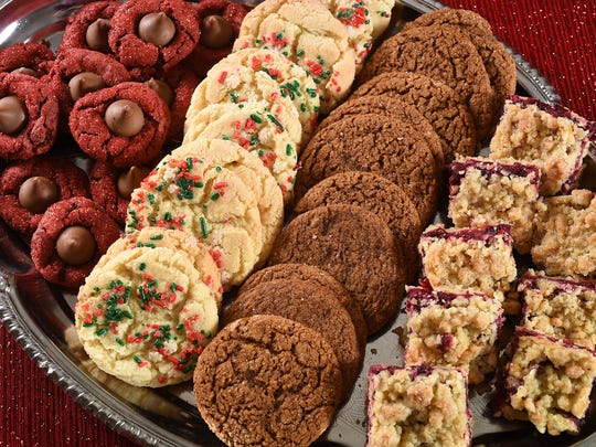 Holiday cookies shown (from left) Red Velvet Peanut Butter Blossoms, Cracked Sugar Cookies, Gingersnaps and Cranberry Bars.