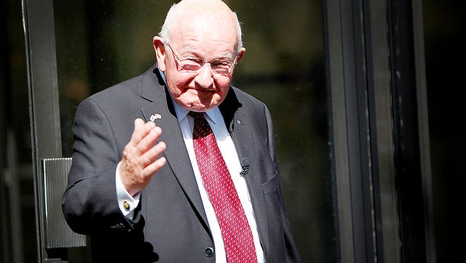 Glenn Wilcox, owner and founder of Wilcox Travel and World Tours, exits the BB&T building at 1 N Pack Square Tuesday after over 50 years of working with his business at that location.