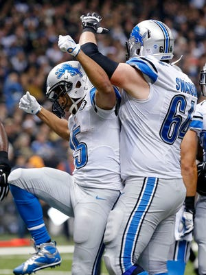 Detroit Lions wide receiver Golden Tate (15) celebrates his touchdown reception with center Travis Swanson (64) in the first half of an NFL football game against the New Orleans Saints in New Orleans, Monday, Dec. 21, 2015.