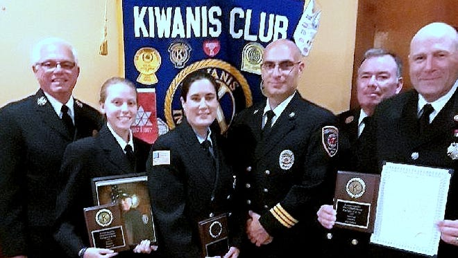The Horseheads Kiwanis Club recently honored three local firefighters. From left are Town & Country Fire Department Chief Don Fischer and firefighter Emily Zine on behalf of her father Michael Zine; Elmira Heights firefighter Amy Savino Witkowski and Chief Michael Cadek; and Horseheads Fire Chief Chief Art Sullivan and firefighter John Hathaway