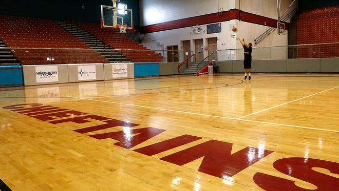 Shiprock High School student Bryson Reed shoots baskets Tuesday during a weight lifting class at the Chieftain Pit in Shiprock.