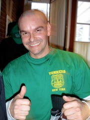 Yonkers police Detective Frank Fernandez at a St. Baldrick's fundraiser where he shaved his head for charity. Fernandez was killed early Sunday when his SUV crashed into a Yonkers fire truck.