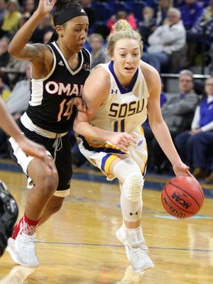 South Dakota State's Madison Guebert (11) drives to the buck past Omaha's Marissa Preston during the second quarter of the Jackrabbits' 76-64 victory over the Mavericks Saturday afternoon at Frost Arena in Brookings.