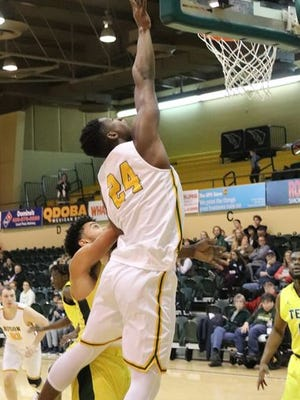 OBU's Mohammed Abubakar (24) goes in for a layup against Arkansas Tech last Saturday during a 75-61 Bison victory.     PHOTO BY BRIAN JOHNSON