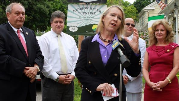 Putnam County Tourism Director Libby Pataki, center,