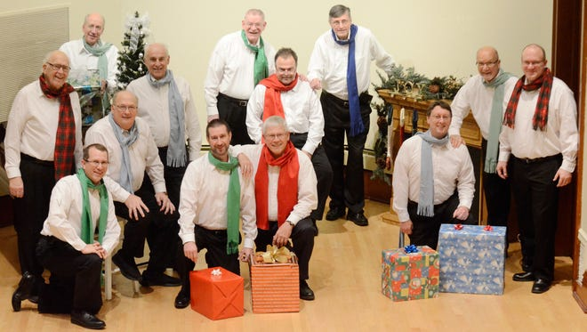 """Clipper City Chordsmen members pose for a portrait during a rehearsal for the group's upcoming Christmas show, """"That's Christmas to Me,"""" on Saturday, Dec. 12."""