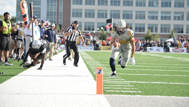 Marian wide receiver Krishawn Hogan makes his way toward the end zone during the Knights' 38-16 win over UIndy.