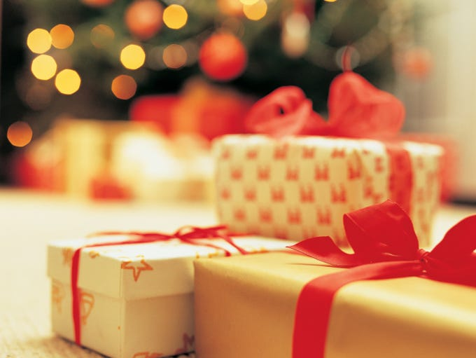 Close-Up of presents with Christmas Tree in background