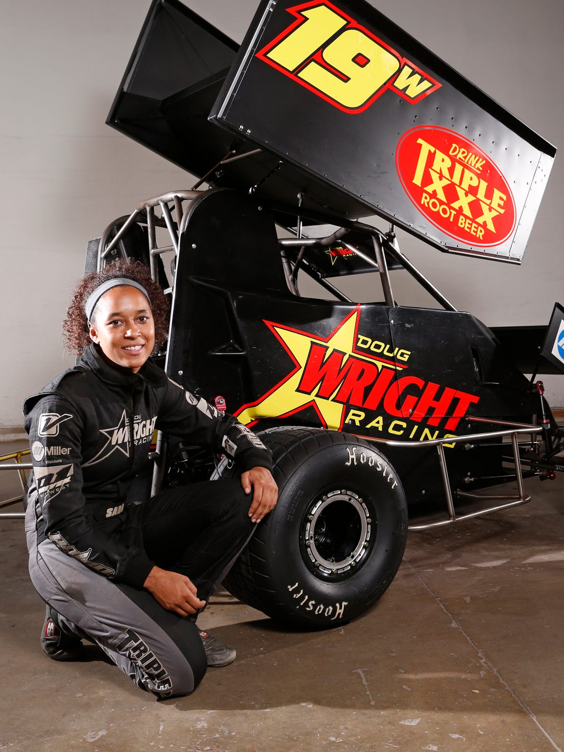 Driver Sara Elrod with her micro sprint car Tuesday,