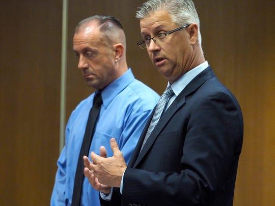 Defense attorney Jeffrey Garrigan (right) speaks on
