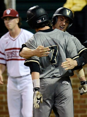 Vanderbilt's Dansby Swanson (7) and Rhett Wiseman, right, celebrate after they both scored to tie it 3-3 on Saturday.