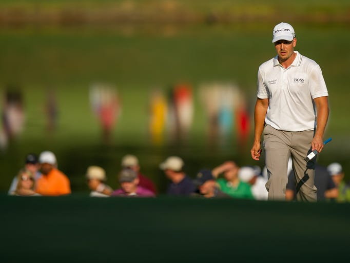 Henrik Stenson approaches the 18th green during the first round of the Tour Championship at East Lake Golf Club.