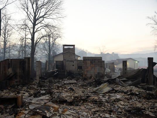 636160945036666691-113016wildfire-destruction.jpg