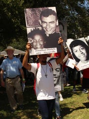 A marcher holds a placard of martyred civil rights activist Jonathan Daniels during Saturday's annual pilgrimage in Hayneville. Alvin Benn/Special to the Advertiser.