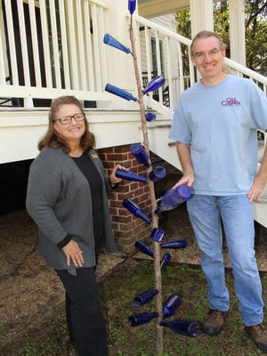 "Old Cahawba Director Linda Derry and assistant Jonathan Matthews examine a ""Bottle Tree"" at the site of Alabama's first capital city. Alvin Benn/Special to the Advertiser."