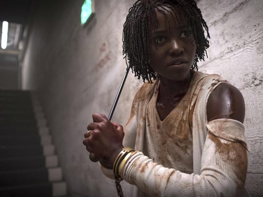 """This image released by Universal Pictures shows Lupita Nyong'o in a scene from """"Us."""" According to new research released Tuesday by the University of Southern California's Annenberg Inclusion Initiative, more of 2019's top movies featured minority or female lead characters than ever recorded before."""