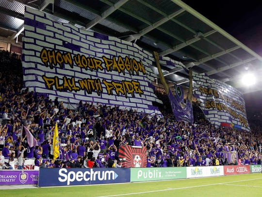 March 3, 2018: Orlando City SC fans hold up a Tifo prior to the game against the D.C. United at Orlando City Stadium. OCSC and D.C. United played to a 1-1 tie.