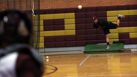 Iona Prep senior Anthony Piccolino, 17, pitches during baseball practice March 23, 2017 in New Rochelle.