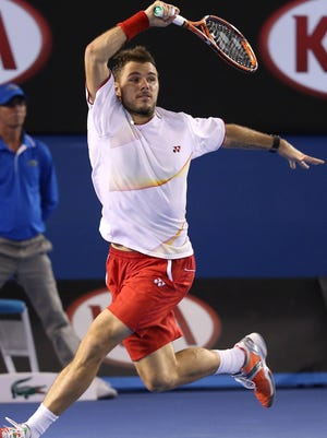 Stanislas Wawrinka  returns a shot against Rafael Nadal in the men's singles championship match Sunday at the Australian Open