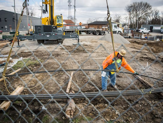 A construction crew works on a draining system adjacent