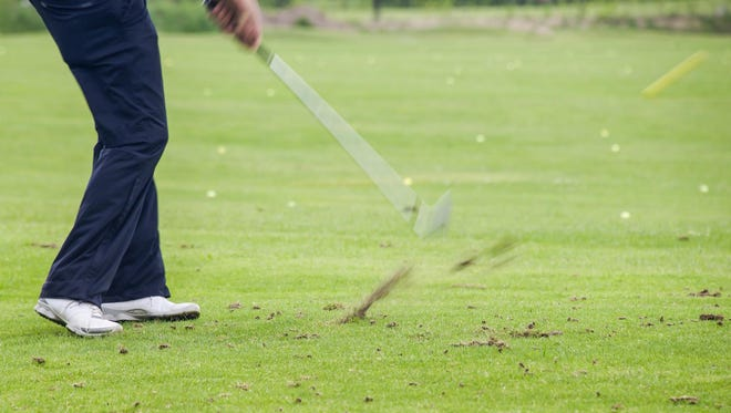 Hitting a ball out of a divot on the course can be challenging.