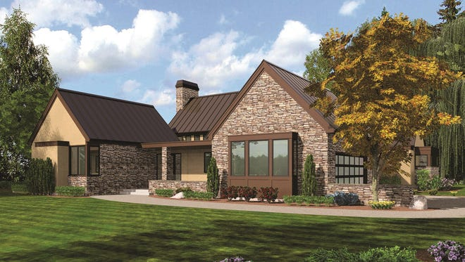 The side-entry garage keeps the focus on the sleek front of this contemporary home.
